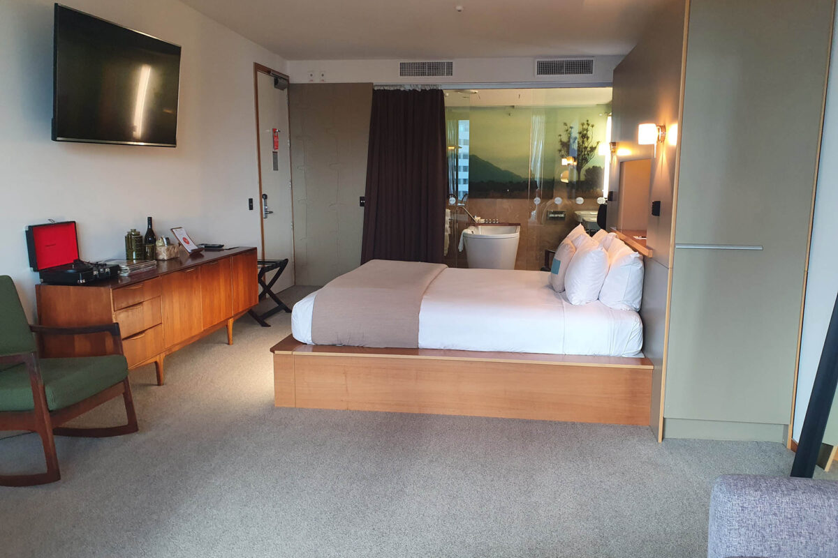 TV, Bed, and Bathroom - Ohtel Suite